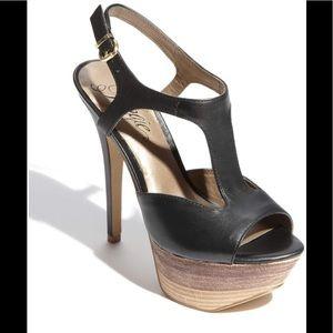 Black strappy heels from Fergie